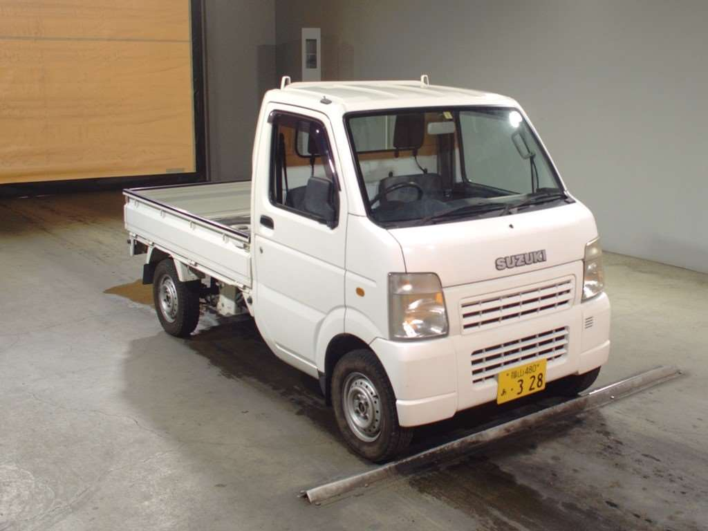 It is a picture of the white suzuki carry  in 2005,First Photo Stock No.Y013741