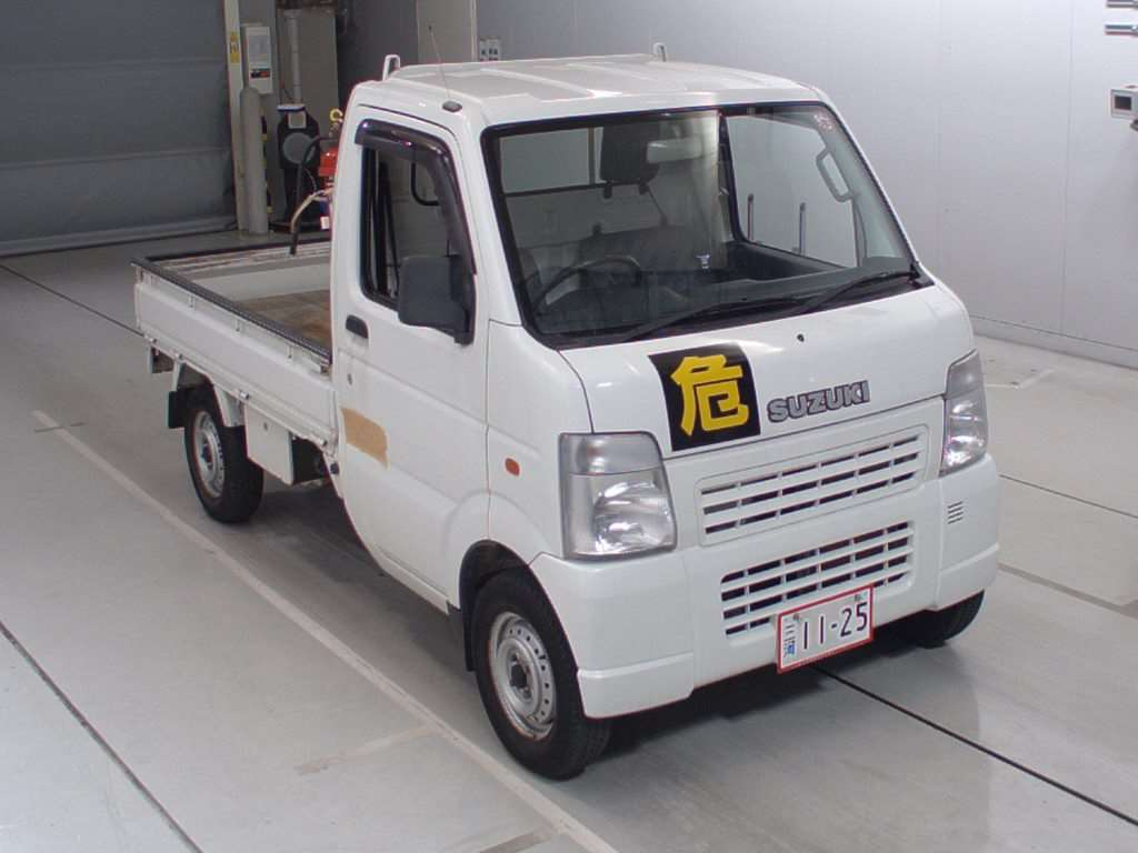 It is a picture of the white suzuki carry  in 2003,First Photo Stock No.Y014320