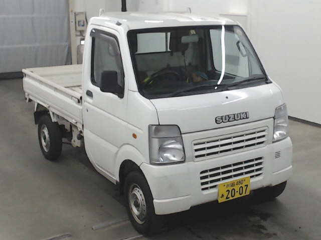 It is a picture of the white suzuki carry  in 2007,First Photo Stock No.Y014347