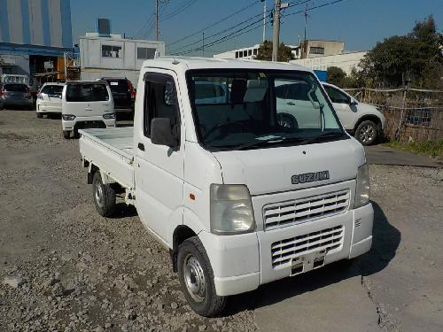 It is a picture of the white suzuki carry  truck in 2002,First Photo Stock No.Y014463