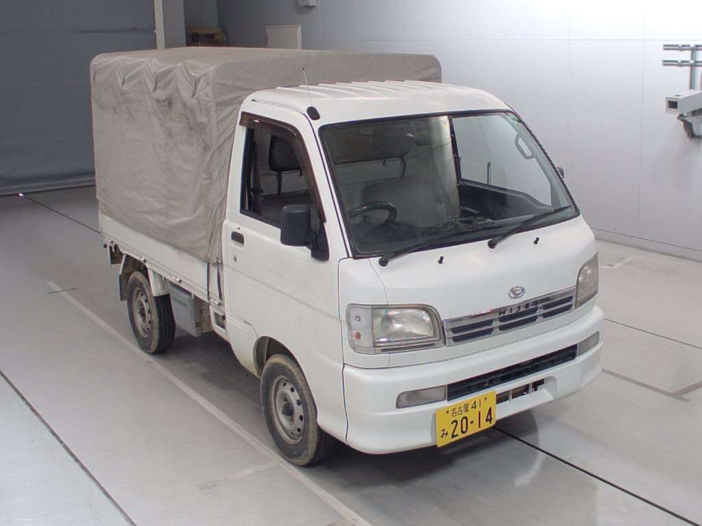It is a picture of the white daihatsu hijet  in 2000,First Photo Stock No.Y014580