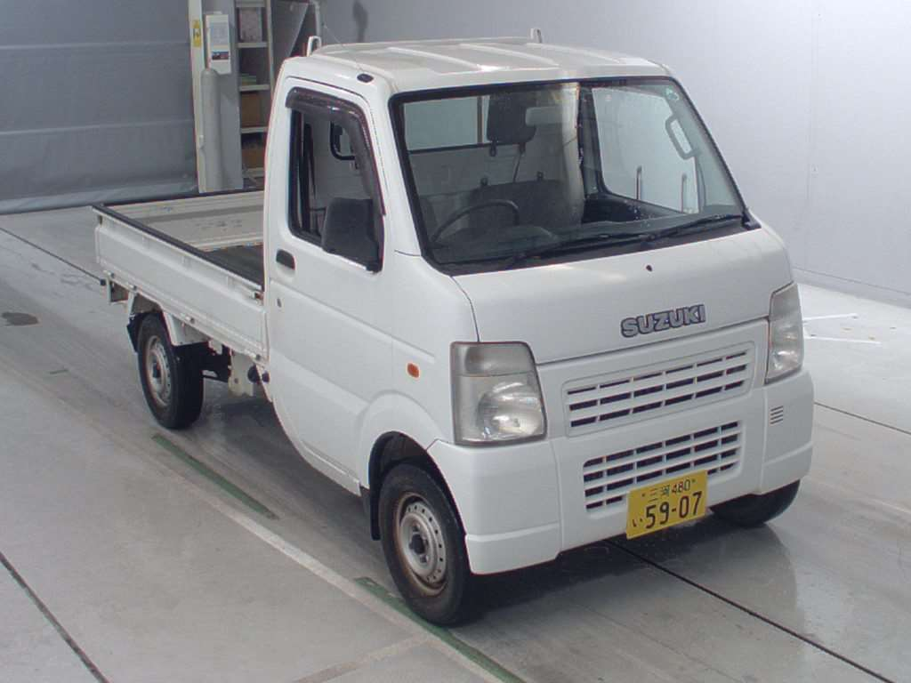 It is a picture of the white suzuki carry  in 2006,First Photo Stock No.Y014581