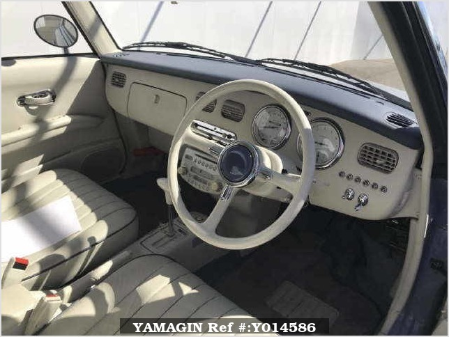It is a picture of the blue nissan figaro open top in 1991,Sub Photo 10 Stock No.Y014586