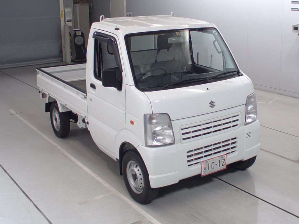 It is a picture of the white suzuki carry truck in 2010,First Photo Stock No.Y015394