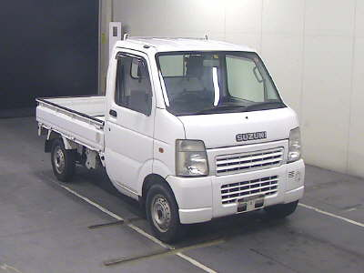 It is a picture of the white suzuki carry  in 2006,First Photo Stock No.Y015419