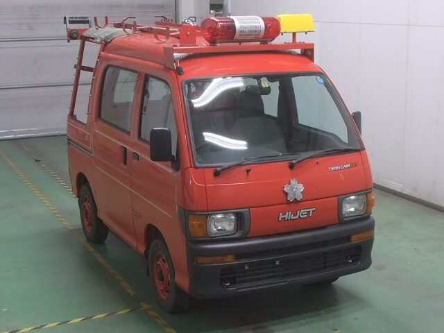 It is a picture of the red daihatsu hijet in 1997,First Photo Stock No.Y015498