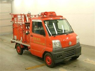 It is a picture of the  red  color substitution  have  mitsubishi minicab in 1999,First Photo Stock No.Y015590