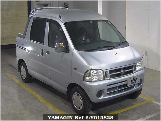 It is a picture of the silver daihatsu hijet in 1999,Sub Photo 0 Stock No.Y015828