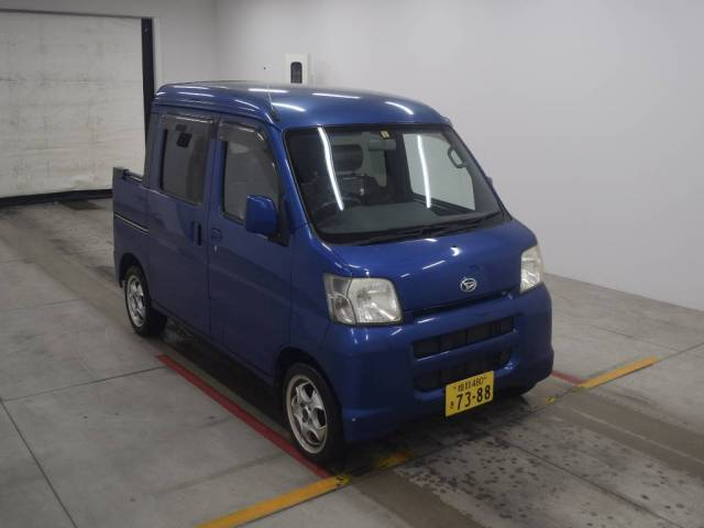 It is a picture of the blue daihatsu hijet  deck van in 2005,First Photo Stock No.Y016150