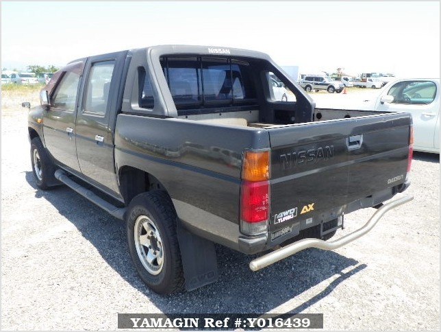 It is a picture of the black 2 nissan datsun truck in 1993,Sub Photo 4 Stock No.Y016439