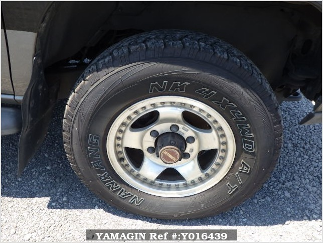 It is a picture of the black 2 nissan datsun truck in 1993,Sub Photo 17 Stock No.Y016439