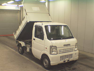 It is a picture of the white suzuki carry  dump in 2006,First Photo Stock No.Y016533