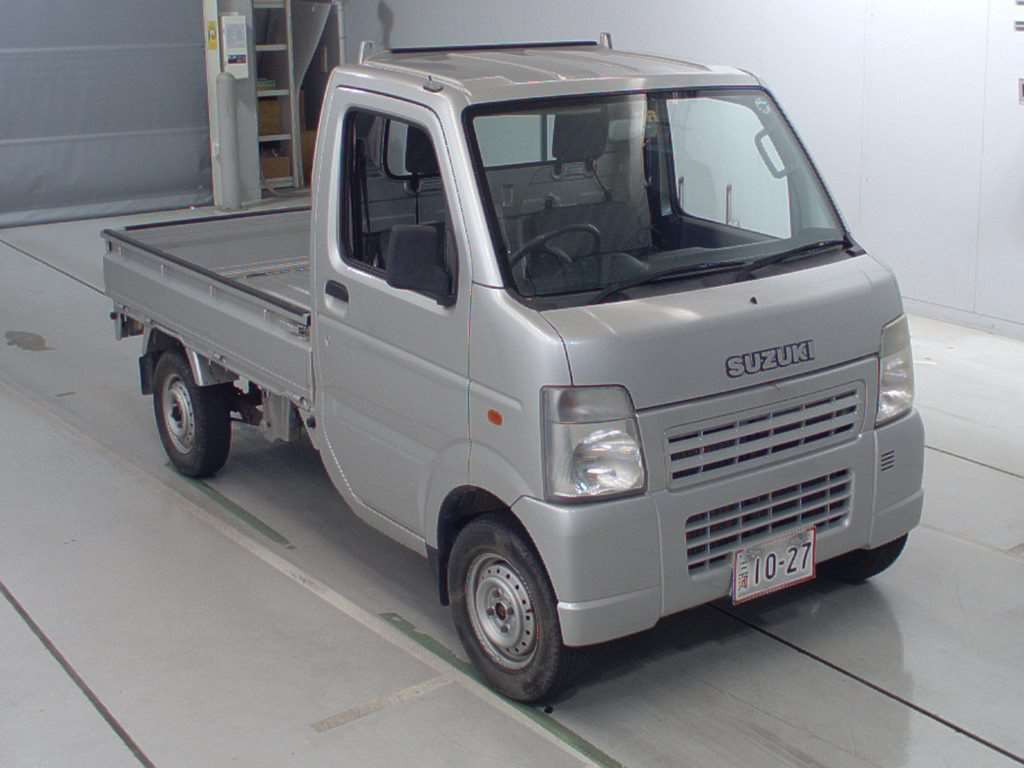 It is a picture of the silver suzuki carry  truck in 2004,First Photo Stock No.Y016706