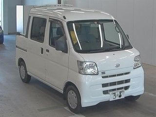 It is a picture of the white daihatsu hijet  deck van in 2008,First Photo Stock No.Y016748