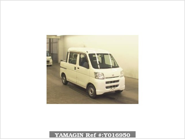 It is a picture of the white daihatsu hijet  deck van in 2006,Sub Photo 0 Stock No.Y016950