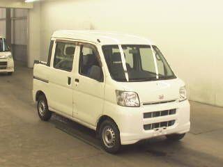It is a picture of the white daihatsu hijet  deck van in 2006,First Photo Stock No.Y016950
