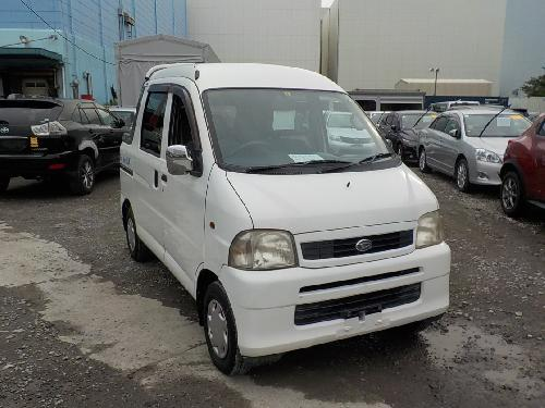 It is a picture of the white daihatsu hijet  deck van in 2002,First Photo Stock No.Y017199