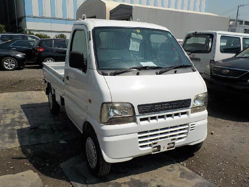 It is a picture of the white suzuki carry truck in 2002,First Photo Stock No.Y017324