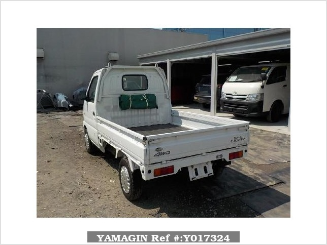 It is a picture of the white suzuki carry truck in 2002,Sub Photo 3 Stock No.Y017324