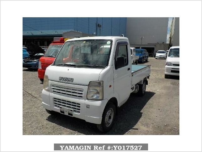 It is a picture of the white suzuki carry truck in 2004,Sub Photo 1 Stock No.Y017527