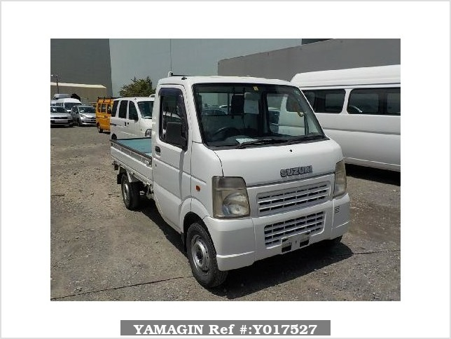 It is a picture of the white suzuki carry truck in 2004,Sub Photo 0 Stock No.Y017527