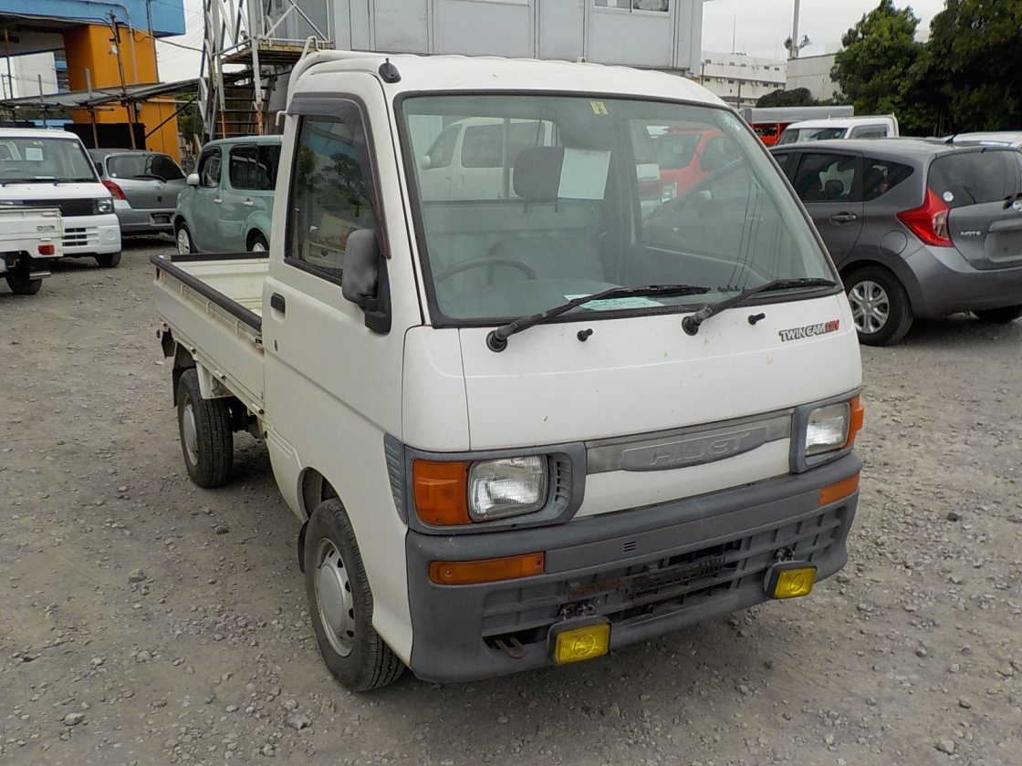 It is a picture of the white daihatsu hijet  truck in 1996,First Photo Stock No.Y018193