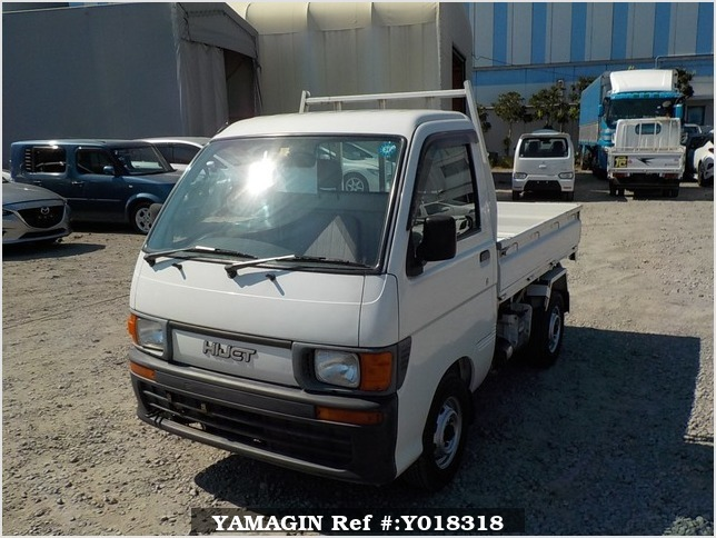 It is a picture of the white daihatsu hijet  scissors dump in 1997,Sub Photo 2 Stock No.Y018318