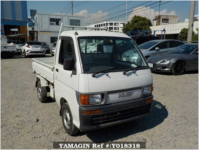 It is a picture of the white daihatsu hijet  scissors dump in 1997,Sub Photo 1 Stock No.Y018318