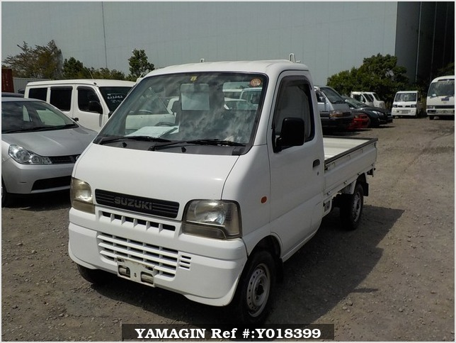 It is a picture of the white suzuki carry truck in 2002,Sub Photo 1 Stock No.Y018399