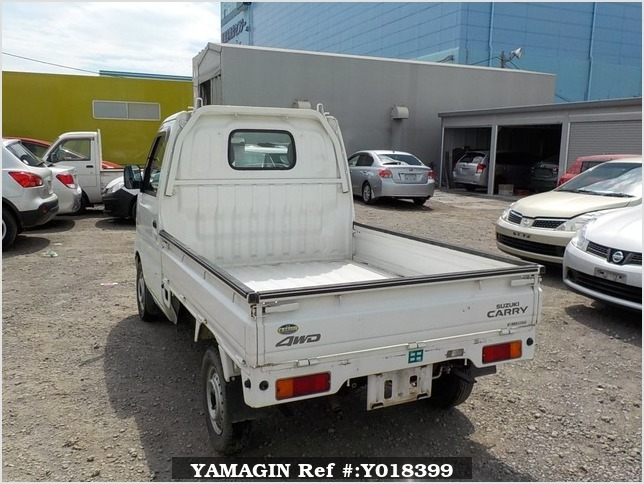 It is a picture of the white suzuki carry truck in 2002,Sub Photo 3 Stock No.Y018399