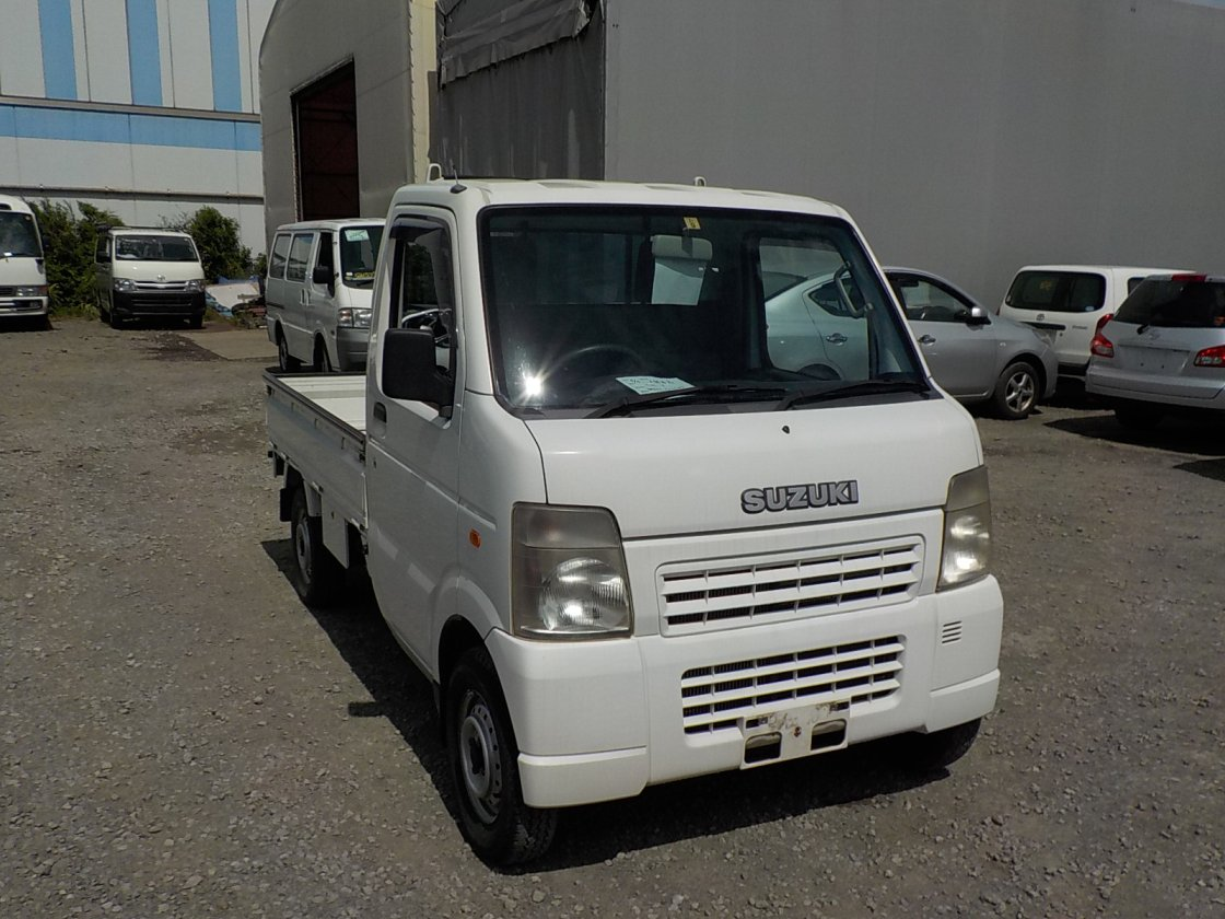 It is a picture of the white suzuki carry truck in 2007,First Photo Stock No.Y018682