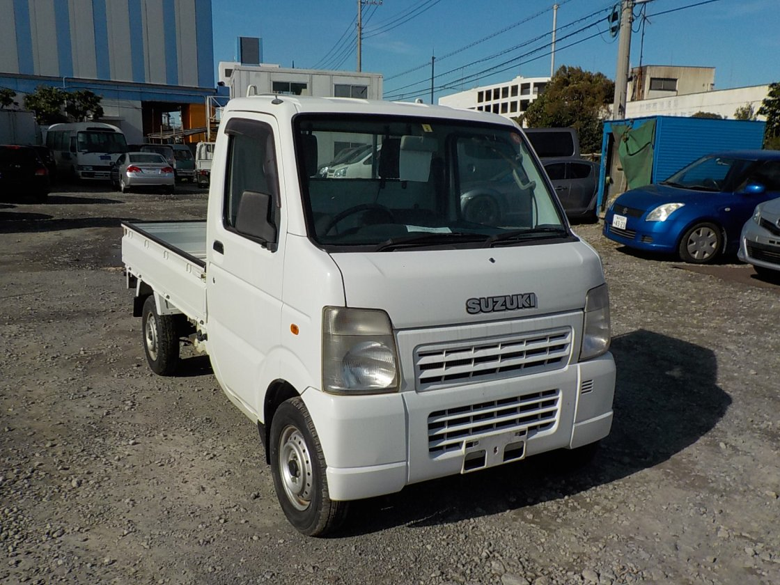 It is a picture of the white suzuki carry truck in 2007,First Photo Stock No.Y018967
