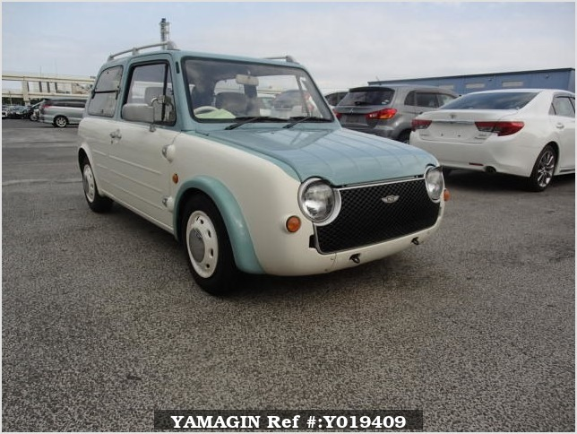 It is a picture of the light blue nissan pao in 1990,Sub Photo 0 Stock No.Y019409