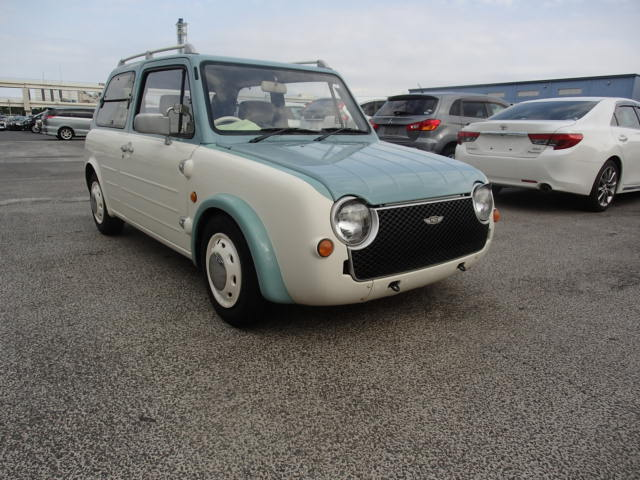 It is a picture of the light blue nissan pao in 1990,First Photo Stock No.Y019409
