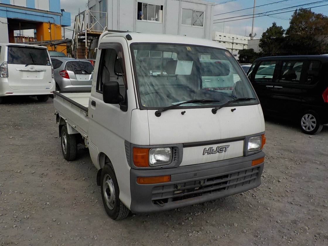 It is a picture of the white daihatsu hijet truck in 1997,First Photo Stock No.Y019437