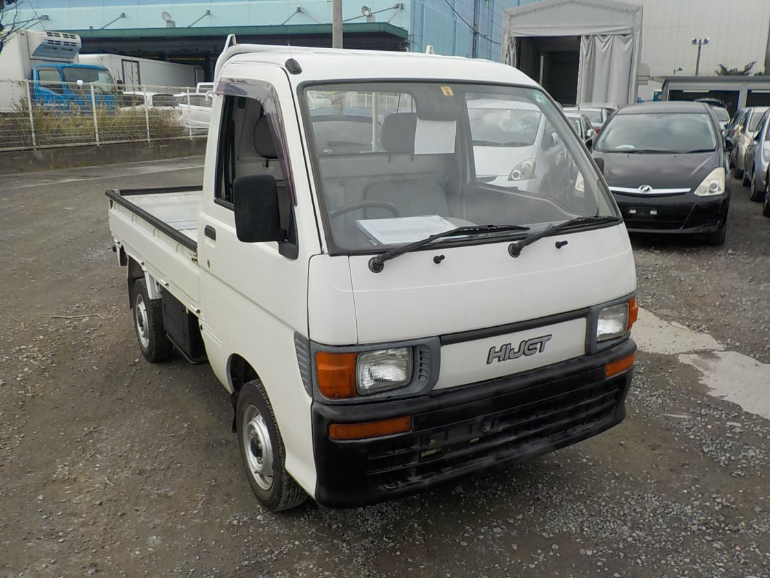It is a picture of the white daihatsu hijet truck in 1994,First Photo Stock No.Y019845