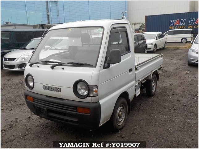 It is a picture of the white suzuki carry truck in 1992,Sub Photo 1 Stock No.Y019907