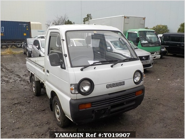 It is a picture of the white suzuki carry truck in 1992,Sub Photo 0 Stock No.Y019907