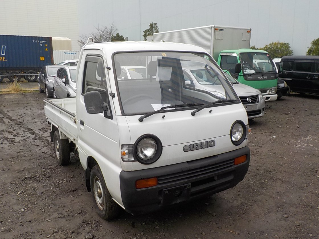 It is a picture of the white suzuki carry truck in 1992,First Photo Stock No.Y019907