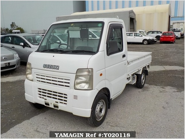 It is a picture of the white suzuki carry truck in 2006,Sub Photo 1 Stock No.Y020118