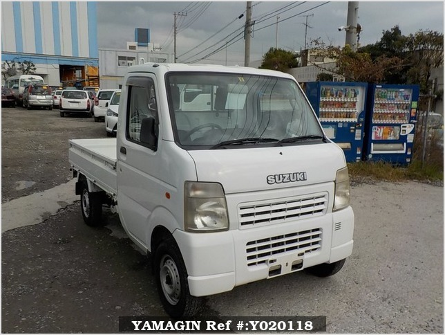 It is a picture of the white suzuki carry truck in 2006,Sub Photo 0 Stock No.Y020118
