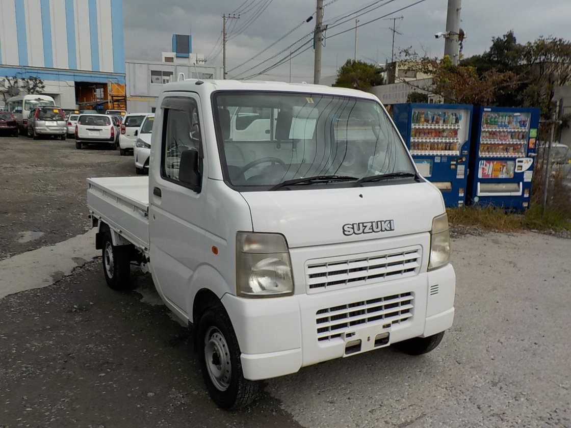 It is a picture of the white suzuki carry truck in 2006,First Photo Stock No.Y020118