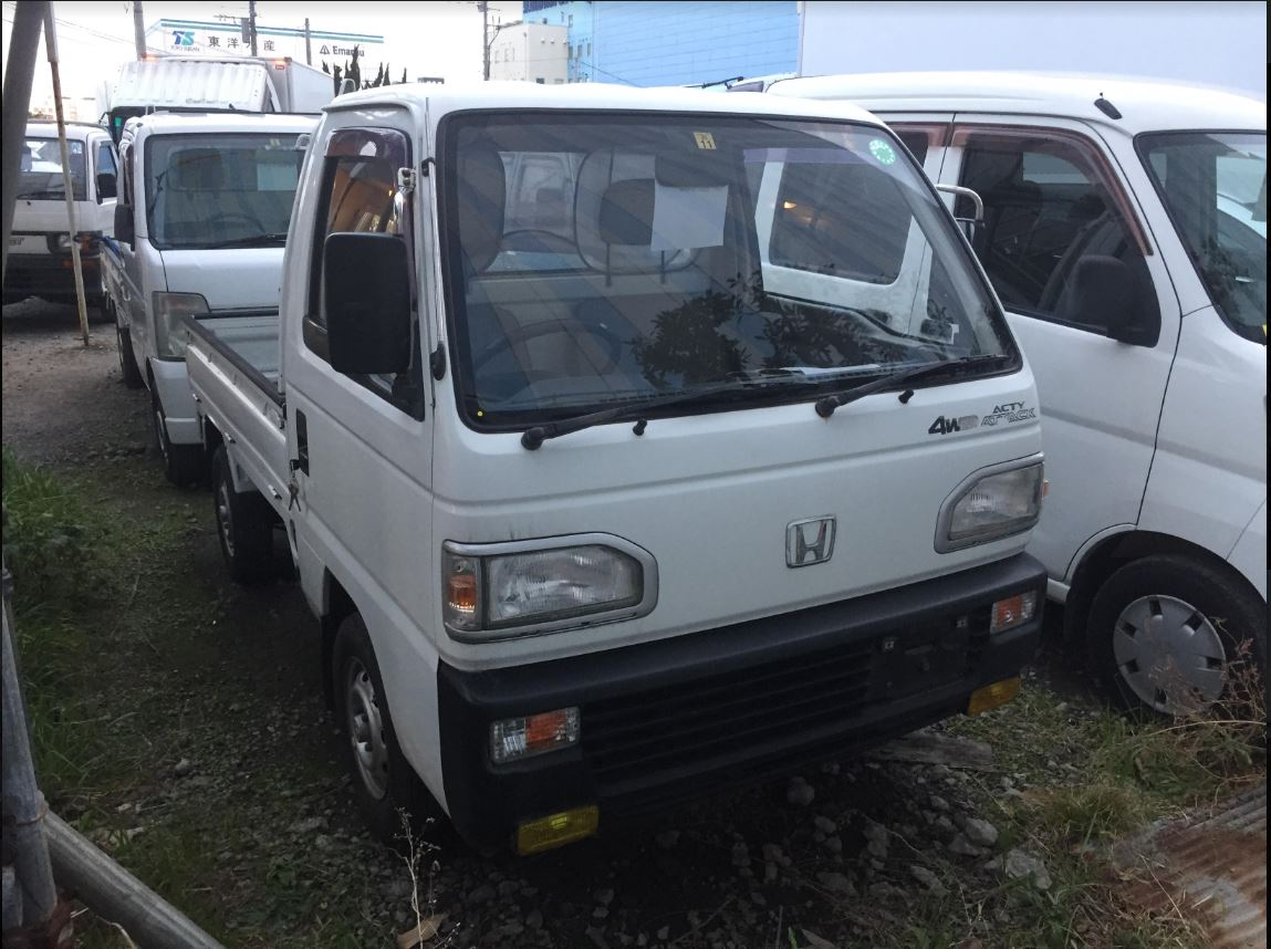 It is a picture of the white honda acty truck in 1991,First Photo Stock No.Y020178