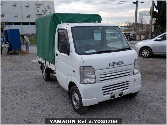 It is a picture of the white suzuki carry truck in 2003,Sub Photo 1 Stock No.Y020766