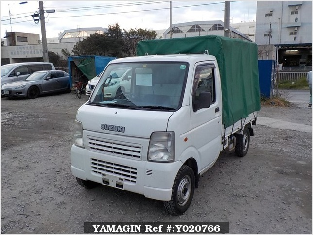 It is a picture of the white suzuki carry truck in 2003,Sub Photo 0 Stock No.Y020766