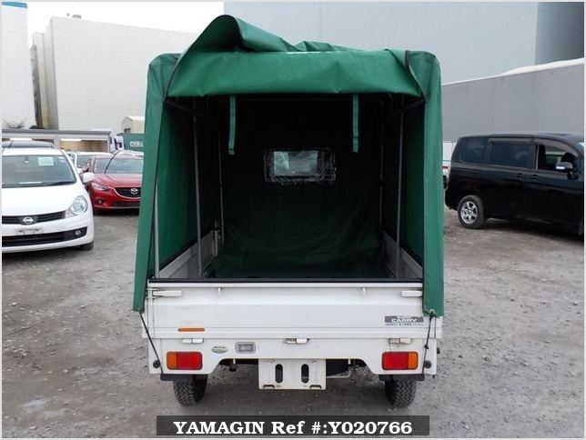 It is a picture of the white suzuki carry truck in 2003,Sub Photo 4 Stock No.Y020766