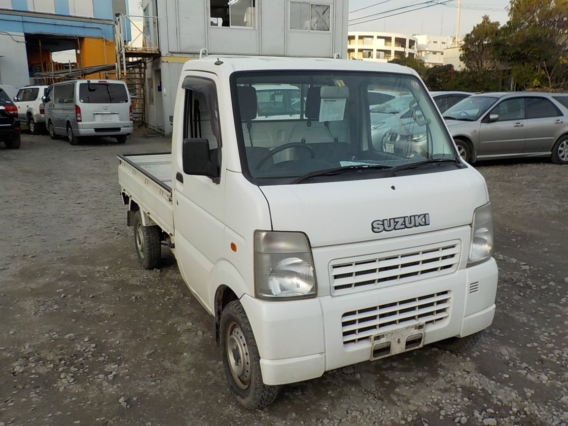It is a picture of the white suzuki carry truck in 2007,First Photo Stock No.Y021016