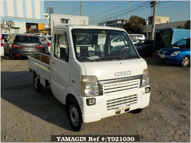It is a picture of the white suzuki carry truck in 2004,Sub Photo 0 Stock No.Y021030