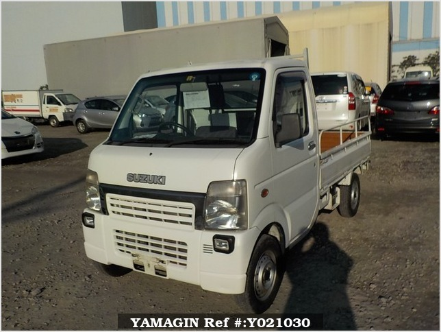 It is a picture of the white suzuki carry truck in 2004,Sub Photo 1 Stock No.Y021030