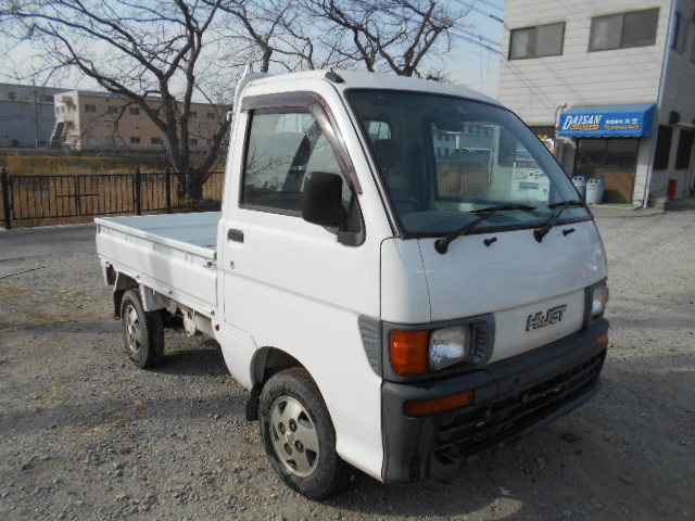 It is a picture of the white daihatsu hijet truck in 1997,First Photo Stock No.Y021345